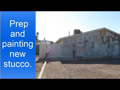 Painting new stucco.