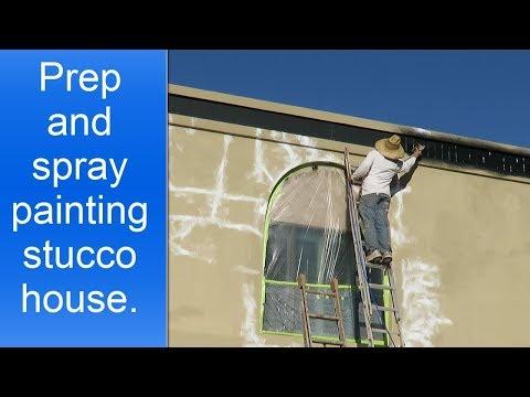 Spray painting stucco house.