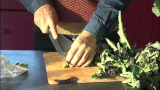 Guy cooks with Purple Sprouting Broccoli