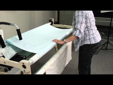 attaching fabric to a wooden grace quilting frame