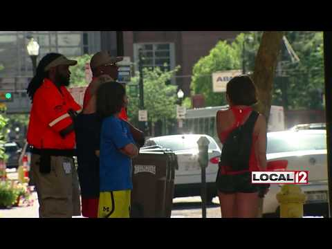 Drivers walk away unhurt after car flips in downtown crash