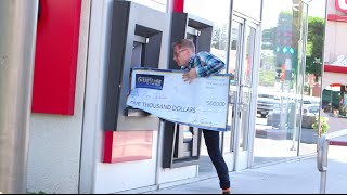 Magician tries to cash GIANT check