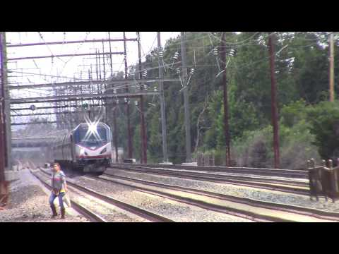 Oblivious Trespasser Crosses in front of Amtrak Train 143 at Norwood Station