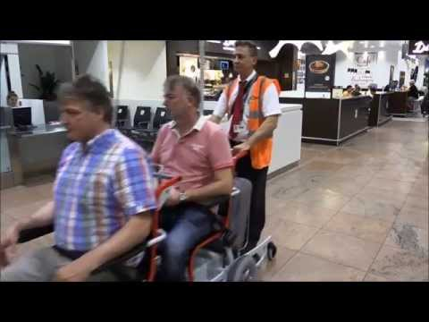 Electric powered transportwheelchair with function to collect empty wheelchairs