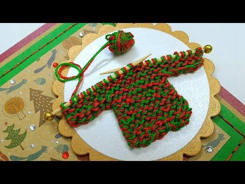 Miniature hand knitted sweater on Christmas card
