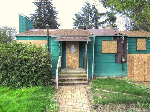 Flip this house!  Boarded up Seattle home up for sale at $450k