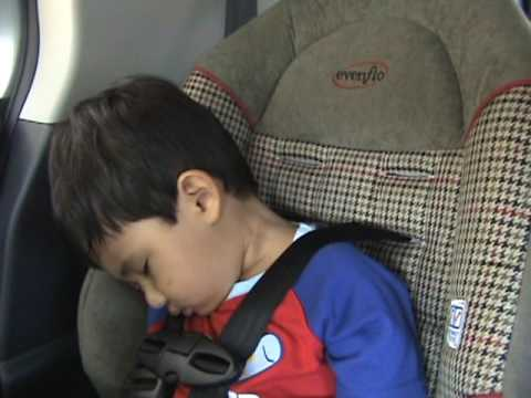 child sleeping in car seat with his head bobbing and slumping.