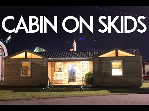 SMALL MOBILE CABIN ON SKIDS WITH BUILT-IN PORCH