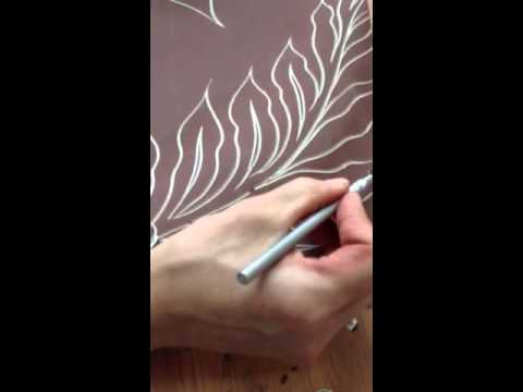 Carving a ceramic wall tile