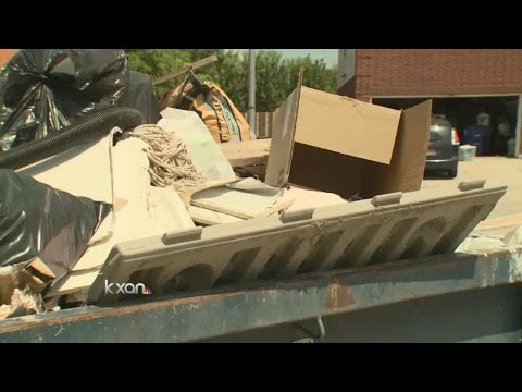 Homeowner told flood debris violates HOA rules