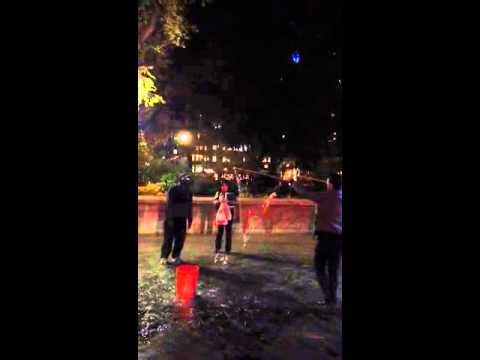 Guy making big bubbles with string