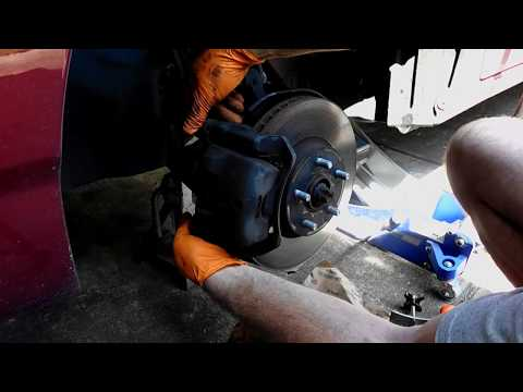Toyota Corolla front brake pad replacement.