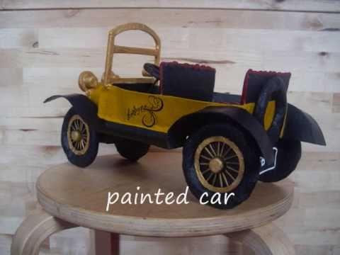 Making a paper mache car.