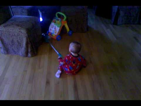 One year old starts Swiffer Vac cleaning service
