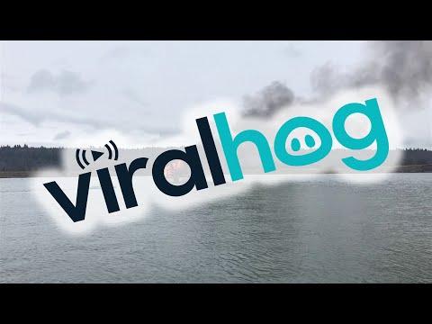 Kayak Rescues Fisherman from Burning Boat || ViralHog