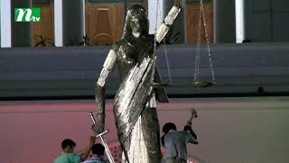 Sculpture being removed from the Supreme Court premises