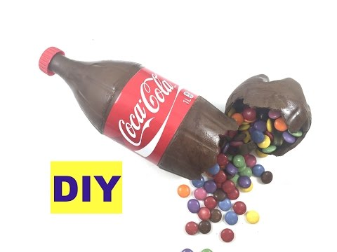 Chocolate Coke  Bottle-Coca Cola cake filled with smarties and gummy coke bottle