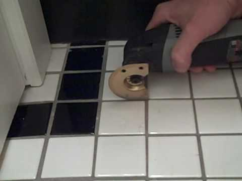 Removing a Broken Floor Tile with Dremel and ToolSnob.com