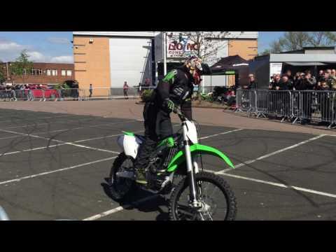 Lee Bowers stunting scraping wheelies on a Kawasaki dirt bike