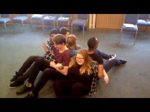 Standing up with linked arms: Teamwork challenge