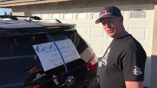 How to install a large vinyl sticker on the rear window of a vehicle