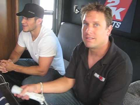 Kevin Bieksa and Mike Rhinehart of 2K Sports demo NHL 2K11