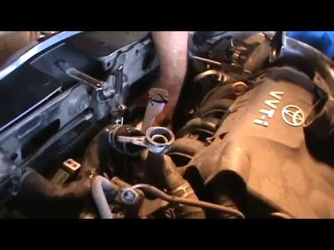 2007 Toyota Yaris coolant expansion assembly replacement
