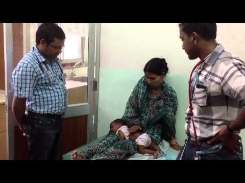 Burping a baby to relieve Aerophagia supervised by resident