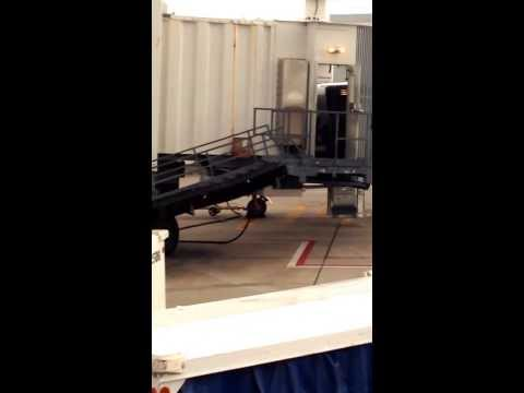 United Airlines Jetway worker throwing gate checked baggage. Noticed him throw a bag off the jet way