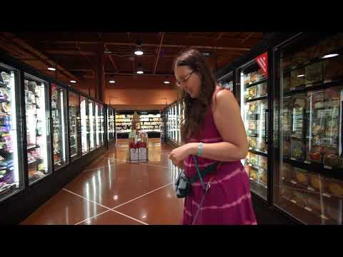 Service dog in grocery store freezer aisle