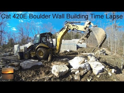 Boulder Wall Building Time Lapse - Cat 420E Backhoe & 299D XHP Skid Steer