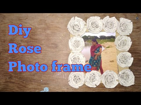 Diy photo frame with rose made from egg cartoon box.