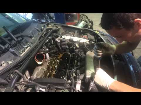 Time lapse removal of valve cover and intake manifold on 225HP Audi TT.