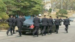 Watch: Kim Jong Un's security guards running beside his car