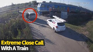 Motorist exits vehicle seconds before it is hit by train