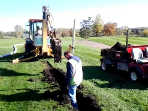 Digging a drainage trench