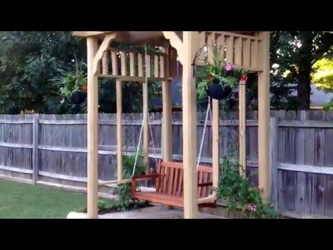 Backyard makeover by BJ's Home Improvement. Pergola swing, deck, and landscaping.