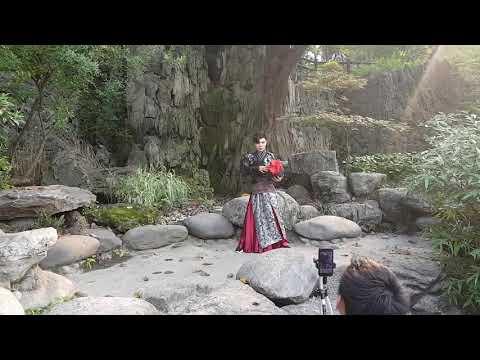 Asian guys shooting scene in park in China