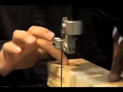 Guy cuts block of wood with a bandsaw and makes a deer  magic
