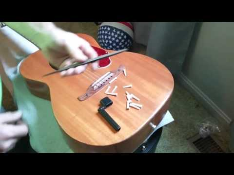 Acoustic guitar Change bridge pins with the use of a capo and quick key wrench