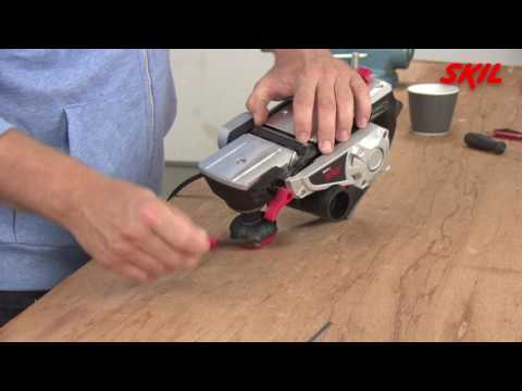 How to replace the planing blades on an electric planer?