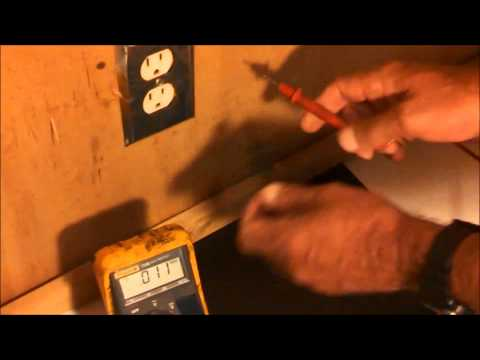 Using a multimeter to check an ac wall outlet
