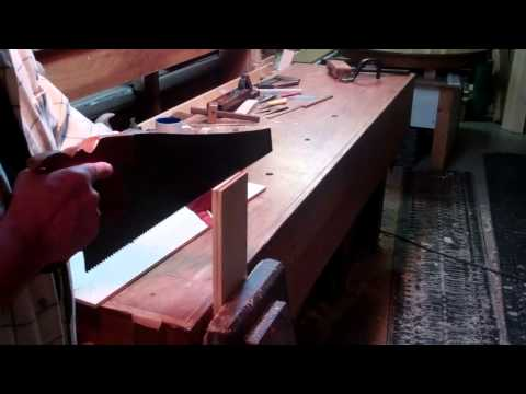 Using a hand saw to rip boards to thickness
