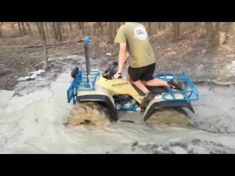 Honda fourtrax 300 on 31 inch outlaws with an axle paddle