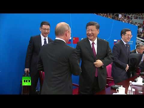 Putin in China: Riding bullet train, attending hockey match