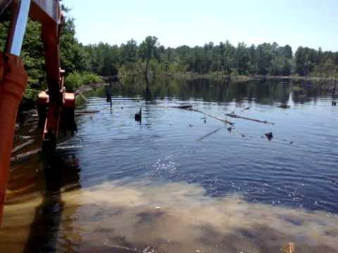 breaking beaver dam to build logging road part 2
