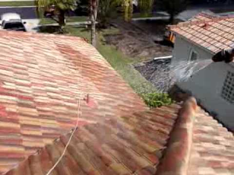 Chemically cleaning a tile roof and pressure washing a driveway in Windermere / Orlando