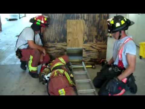 Firefighter down folding ladder