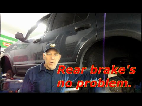 How to replace rear brakes,rotor and parking brake shoes on a Ford Explorer