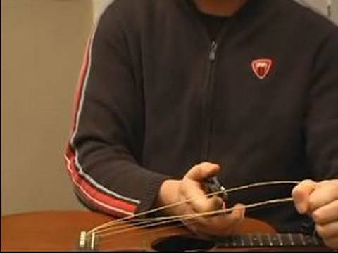 How to String a Guitar : How to Remove Guitar Strings from the Bridge